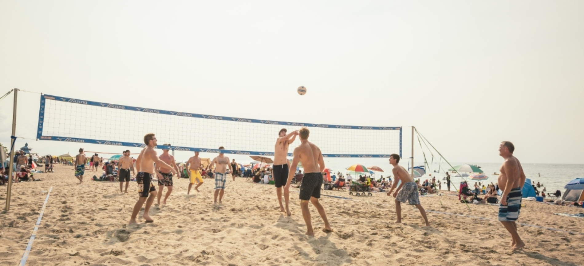 Group playing volleyball on the beach